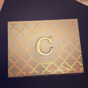 "Glass jewelry box with ""C"" monogram"